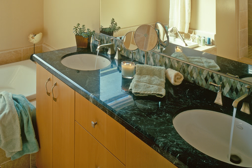 Alder Bathroom Cabinets with Bookmatched Aires Doors Double Sink