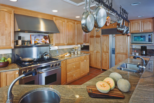Kitchen Cabinets with Alder Wood Medium Brown Stain Arched Doors Raised Panel Doors Two-tiered Island