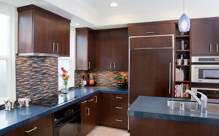 Kitchen Cabinets with Bookmatched Aires Doors Wood Panels on Refrigerator Sink in the Island Flat Crown